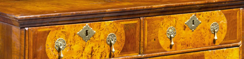 A veneered chest of drawers
